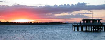 Bribie Island sunset with Bongaree Jetty in foreground